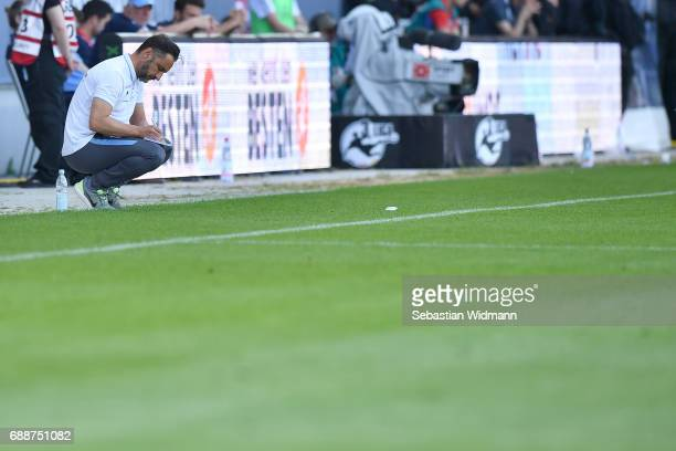 Head coach Vitor Pereira of 1860 Muenchen takes notes during the Second Bundesliga Playoff first leg match between Jahn Regensburg and TSV 1860...