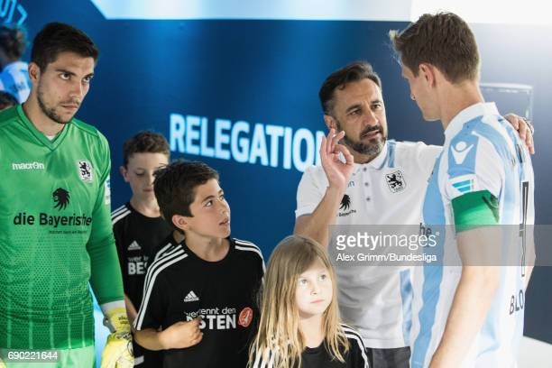 Head coach Vitor Pereira of 1860 Muenchen talks to team captain Kai Buelow in the tunnel prior to the 2 Bundesliga Playoff leg 2 match between 1860...
