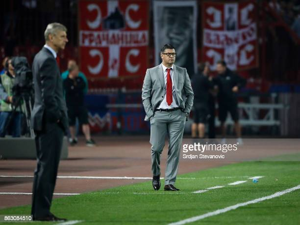 head coach Vladan Milojevic of Crvena Zvezda and manager Arsene Wenger of Arsenal look on during the UEFA Europa League group H match between Crvena...
