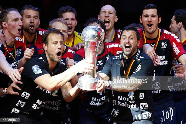 Head coach Vranjes Ljubomir of Flensburg celebrates with the tropy after the DHB Cup Final match between SG FlensburgHandewitt and SC Magdeburg at O2...