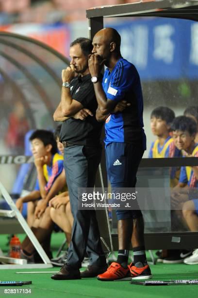 Head coach Wagner Lopes of Albirex Niigata and assistant coach Sandro look on during the JLeague J1 match between Albirex Niigata and Kawasaki...