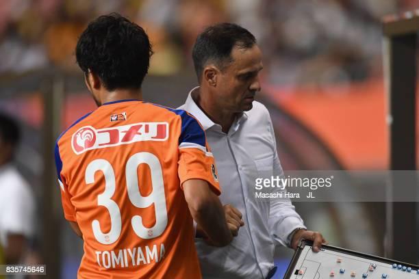 Head coach Wagner Lopes of Albirex Niigata gives instruction to Takamitsu Tomiyama during the JLeague J1 match between Albirex Niigata and Vegalta...