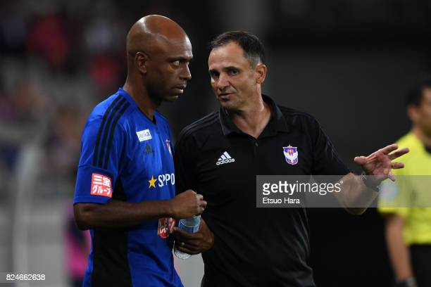 Head coach Wagner Lopes of Albirex Niigata speaks to his assistant Sandro Rosa during the JLeague J1 match between FC Tokyo and Albirex Niigata at...