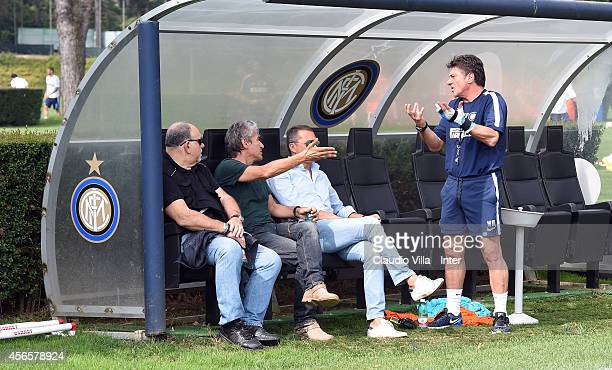 Head coach Walter Mazzarri and Luciano Ligabue talk after an FC Internazionale training session at the club's training ground at Appiano Gentile on...