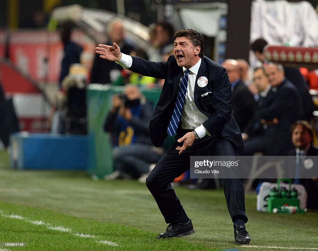 Head coach <a gi-track='captionPersonalityLinkClicked' href=/galleries/search?phrase=Walter+Mazzarri&family=editorial&specificpeople=5314636 ng-click='$event.stopPropagation()'>Walter Mazzarri</a> of FC Inter Milan reacts during the Serie A match between FC Internazionale Milano and Hellas Verona at Stadio Giuseppe Meazza on October 26, 2013 in Milan, Italy.