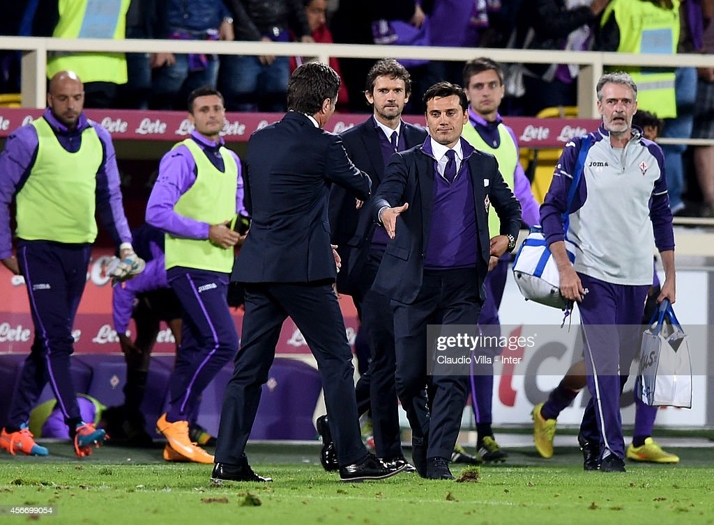 Head coach Walter Mazzarri of FC Internazionale (L) and head coach ACF Fiorentina Vincenzo Montella after the Serie A match between ACF Fiorentina and FC Internazionale Milano at Stadio Artemio Franchi on October 5, 2014 in Florence, Italy.