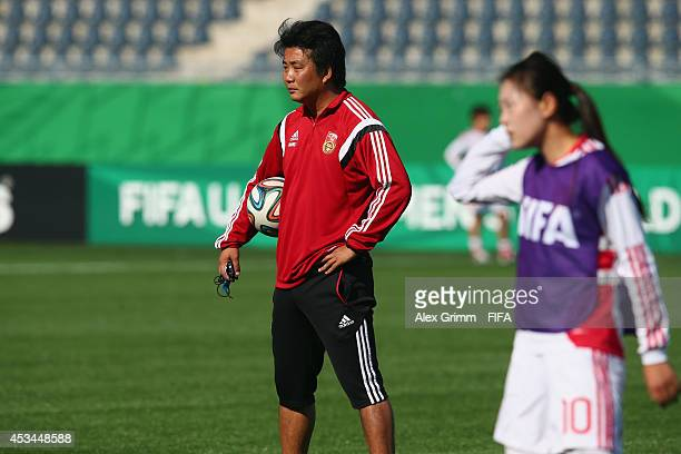 Head coach Wang Jun attends a China training session at Moncton stadium on August 8 2014 in Moncton Canada