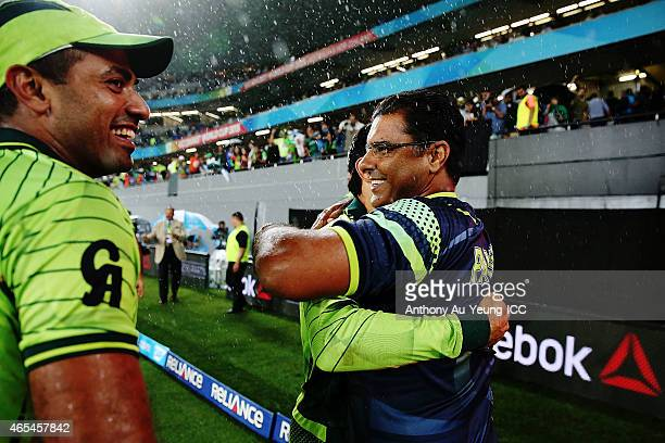 Head Coach Waqar Younis of Pakistan congratulates the team after winning the 2015 ICC Cricket World Cup match between South Africa and Pakistan at...