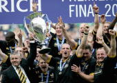 Head coach Warren Gatland and captain Lawrence Dallaglio hold up the trophy after winning the Zurich Premiership Final match between Leicester Tigers...