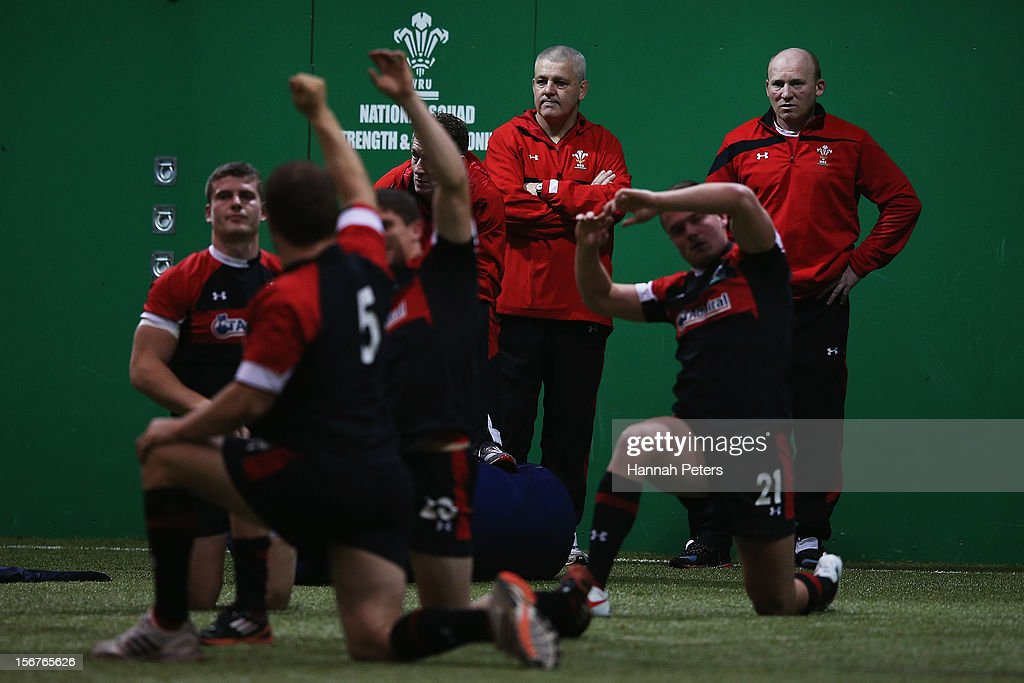 Head coach <a gi-track='captionPersonalityLinkClicked' href=/galleries/search?phrase=Warren+Gatland&family=editorial&specificpeople=686626 ng-click='$event.stopPropagation()'>Warren Gatland</a> of Wales looks on as the team stretches during a training session at the Vale resort on November 20, 2012 in Cardiff, Wales.