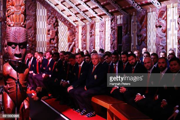 Head coach Warren Gatland the team listen to speeches inside the meeting house during the British Irish Lions Maori Welcome at Waitangi Treaty...