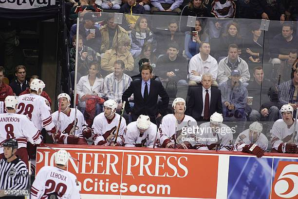 Head coach Wayne Gretzky of the Phoenix Coyotes watches from the bench against the Minnesota Wild at Xcel Energy Center on November 8 2005 in Saint...