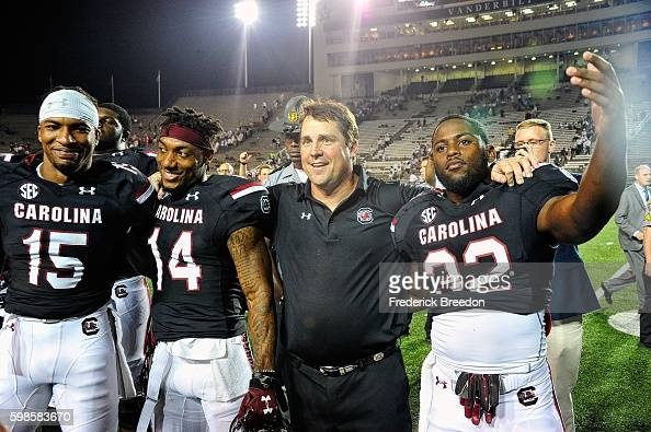 Head coach Will Muschamp celebrates with Matrick Belton Jamari Smith and Rod Talley after a 1310 victory over the Vanderbilt Commodores at Vanderbilt...