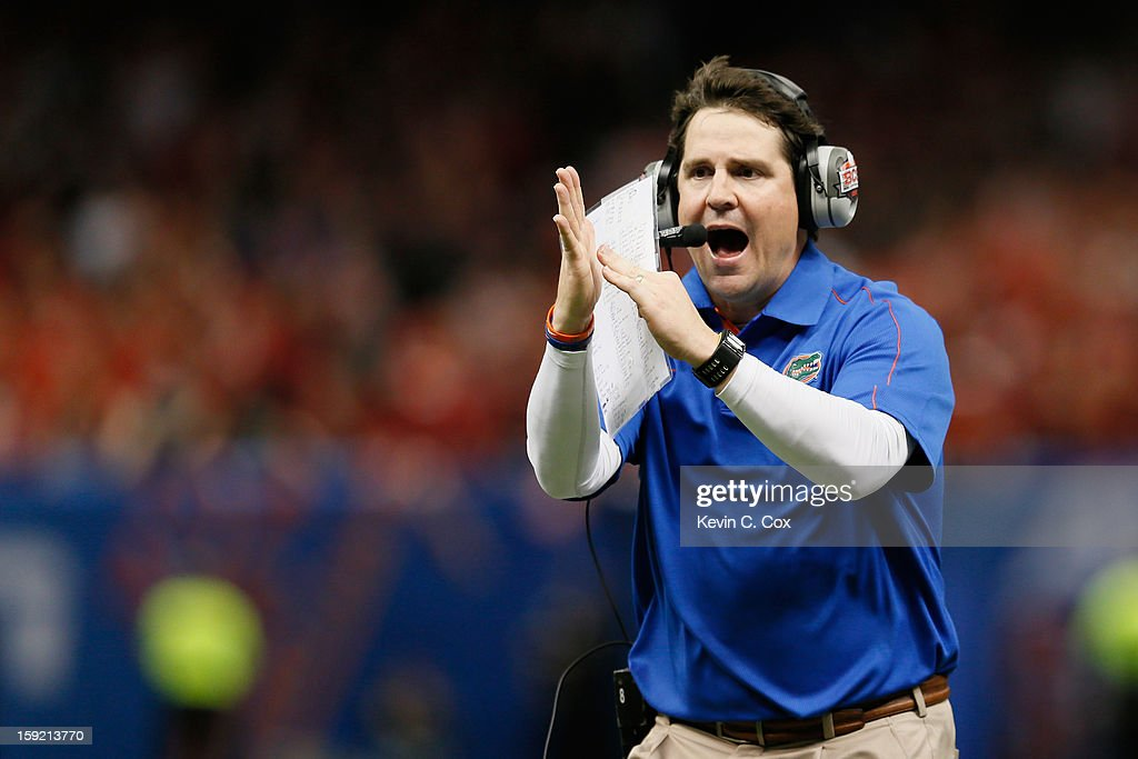 Head coach Will Muschamp of the Florida Gators calls for a time out in the third quarter against the Louisville Cardinals during the Allstate Sugar Bowl at Mercedes-Benz Superdome on January 2, 2013 in New Orleans, Louisiana.