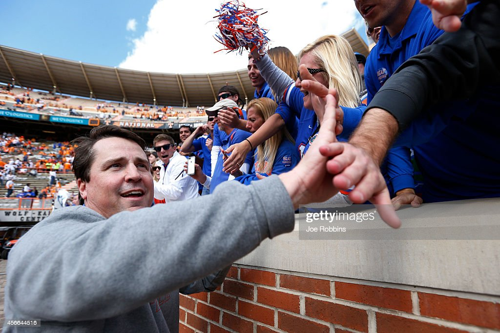 Head coach Will Muschamp of the Florida Gators celebrates with fans after the game against the Tennessee Volunteers at Neyland Stadium on October 4...