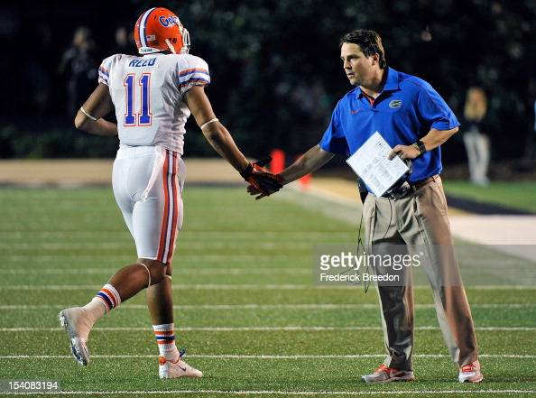 Head coach Will Muschamp of the Florida Gators greets Jordan Reed as he leaves the field against the Vanderbilt Commodores at Vanderbilt Stadium on...