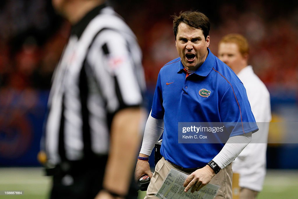 Head coach Will Muschamp of the Florida Gators reacts after failing to get a time out in the third quarter against the Louisville Cardinals during...