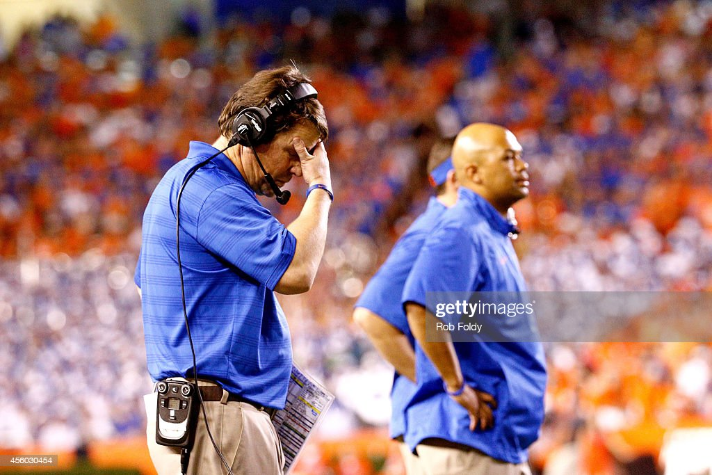 Head coach <a gi-track='captionPersonalityLinkClicked' href=/galleries/search?phrase=Will+Muschamp&family=editorial&specificpeople=2248036 ng-click='$event.stopPropagation()'>Will Muschamp</a> of the Florida Gators reacts during the game against the Kentucky Wildcats at Ben Hill Griffin Stadium on September 13, 2014 in Gainesville, Florida.