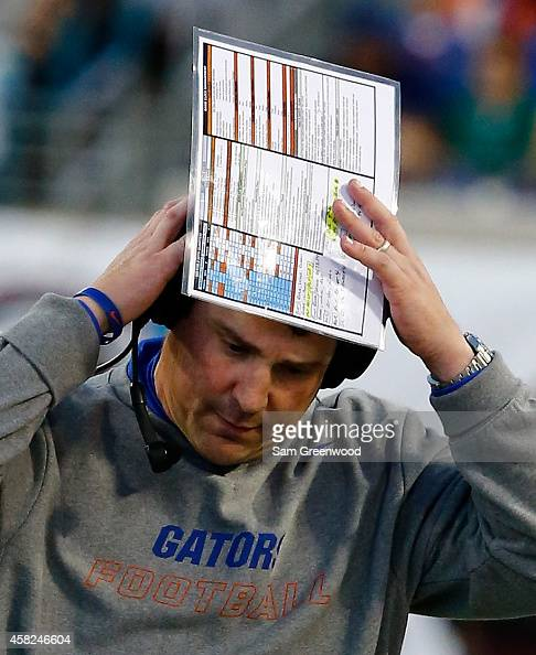 Head coach Will Muschamp of the Florida Gators takes off his headset during the game against the Georgia Bulldogs at EverBank Field on November 1...