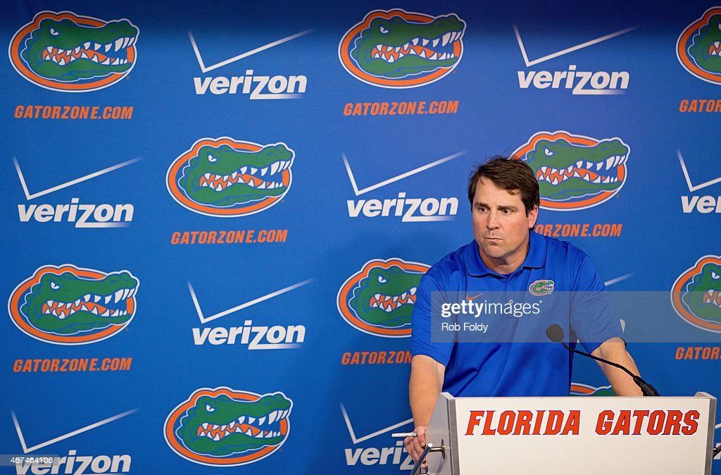 Head coach <a gi-track='captionPersonalityLinkClicked' href=/galleries/search?phrase=Will+Muschamp&family=editorial&specificpeople=2248036 ng-click='$event.stopPropagation()'>Will Muschamp</a> of the Florida Gators talks to the media after the Gators' 43-13 loss to the Missouri Tigers at Ben Hill Griffin Stadium on October 18, 2014 in Gainesville, Florida.