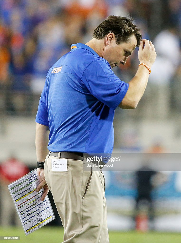 Head coach Will Muschamp of the Florida Gators walks back turnover the sidelines during the game against the Georgia Bulldogs at EverBank Field on November 2, 2013 in Jacksonville, Florida.