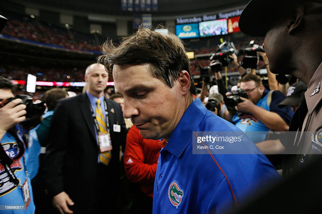 Head coach Will Muschamp of the Florida Gators walks off of the field after the Louisville Cardinals defeated the Gators 33 to 23 in the Allstate Sugar Bowl at Mercedes-Benz Superdome on January 2, 2013 in New Orleans, Louisiana.