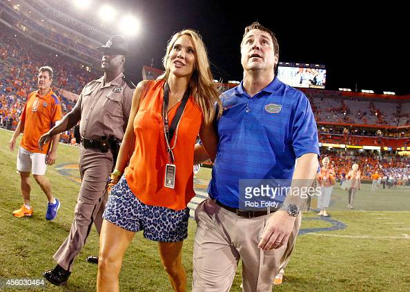 Head coach Will Muschamp of the Florida Gators walks off the field with his wife Carol Muschamp after the game against the Kentucky Wildcats at Ben...