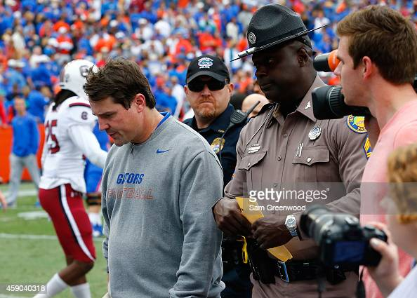 Head coach Will Muschamp of the Florida Gators walks off the field after an overtime loss to the South Carolina Gamecocks at Ben Hill Griffin Stadium...