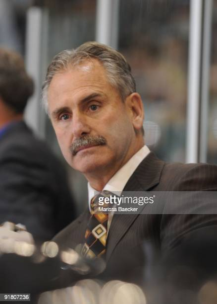 Head coach Willie Desjardins of the Medicine Hat Tigers stands on the bench against the Kelowna Rockets at Prospera Place on October 7 2009 in...