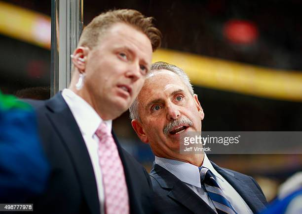 Head coach Willie Desjardins of the Vancouver Canucks talks to Glen Gulutzan during their NHL game against the New Jersey Devils at Rogers Arena...