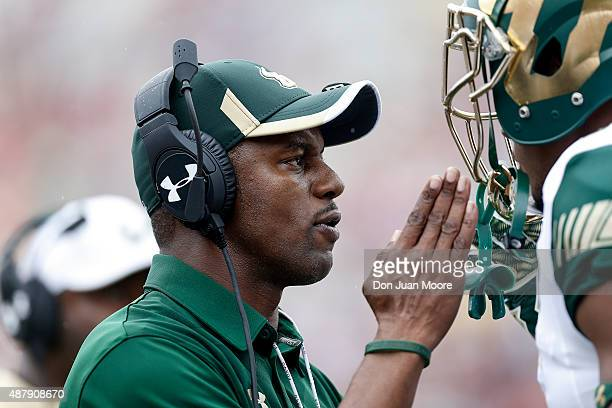 Head Coach Willie Taggart of the South Florida Bulls talks with his player during the game against the Florida State Seminoles at Doak Campbell...