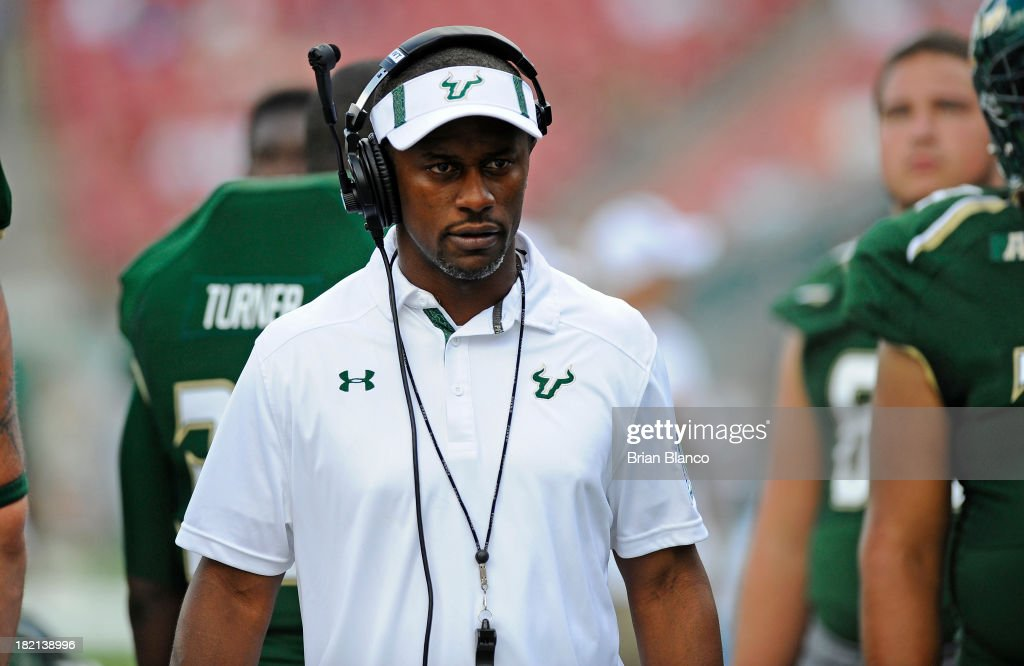 Head Coach Willie Taggart walks the sidelines during the fourth quarter against the Miami Hurricanes on September 28, 2013 at Raymond James Stadium in Tampa, Florida.