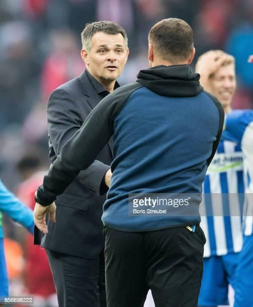 Head coach Willy Sagnol of FC Bayern Muenchen shake hands with head coach Pal Dardai of Hertha BSC after the Bundesliga match between Hertha BSC and...