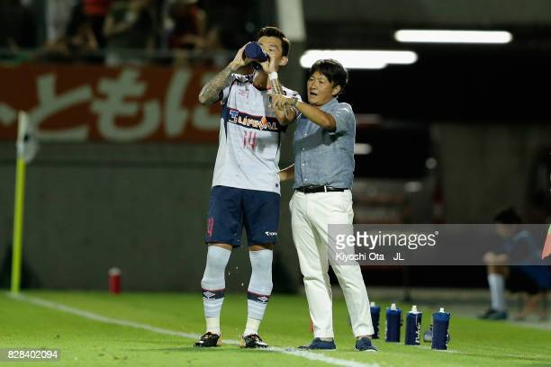 Head coach Yoshiyuki Shinoda of FC Tokyo instructs Jang Hyun Soo during the JLeague J1 match between Omiya Ardija and FC Tokyo at NACK 5 Stadium...