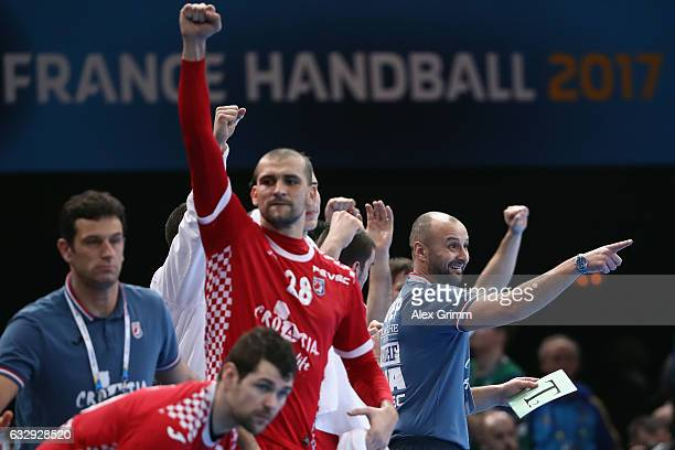 Head coach Zeljko Babic and players of Croatia react during the 25th IHF Men's World Championship 2017 Bronze Medal Game between Slovenia and Croatia...