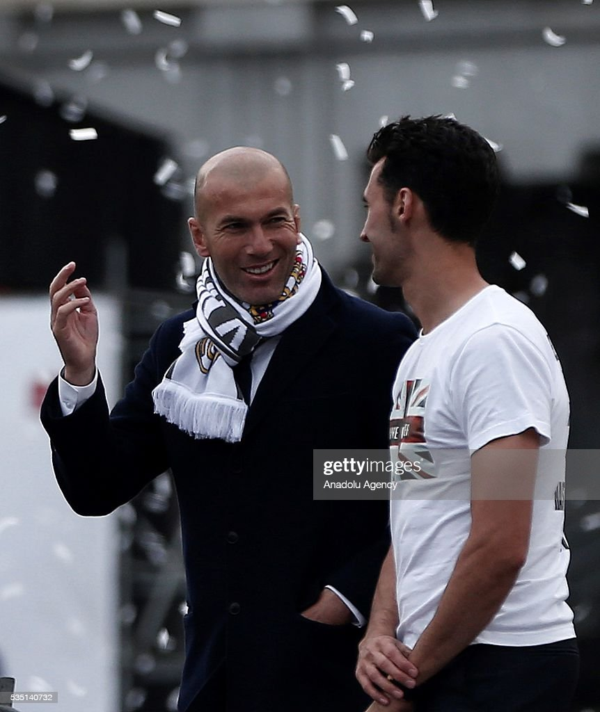 Head coach Zinedine Zidane (L) and Alvaro Arbeloa (R) of Real Madrid CFacelebration at Cibeles square after winning the UEFA Champions League Final match against Club Atletico de Madrid on May 29, 2016 in Madrid, Spain.