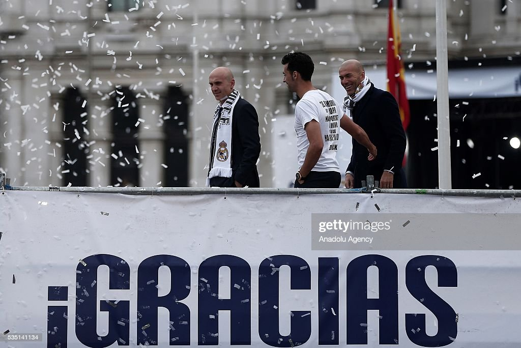 Head coach Zinedine Zidane (R) and Alvaro Arbeloa (C) of Real Madrid CF attend the celebration at Cibeles square after winning the UEFA Champions League Final match against Club Atletico de Madrid on May 29, 2016 in Madrid, Spain.