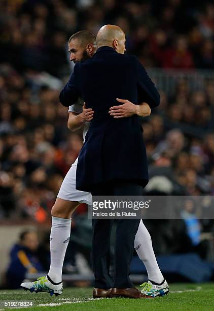 Head coach Zinedine Zidane and Karim Benzema of Real Madrid celebrate after scoring during the La Liga match between FC Barcelona and Real Madrid CF...