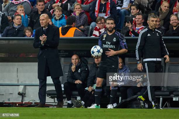 Head coach Zinedine Zidane of Real Madrid and Daniel Carvajal of Real Madrid looks on during the UEFA Champions League Quarter Final first leg match...