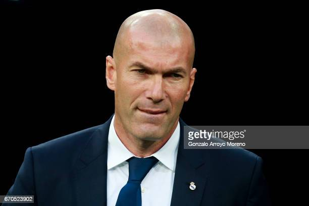 Head coach Zinedine Zidane of Real Madrid CF bites his lip prior to start the UEFA Champions League Quarter Final second leg match between Real...