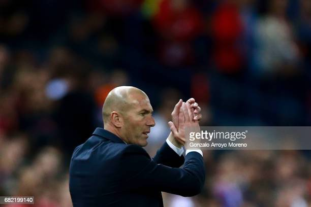 head coach Zinedine Zidane of Real Madrid CF claps during the UEFA Champions League Semi Final second leg match between Club Atletico de Madrid and...