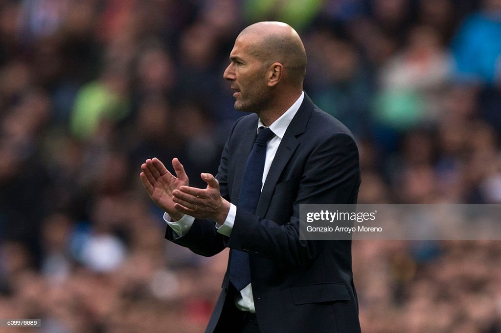 Head coach <a gi-track='captionPersonalityLinkClicked' href=/galleries/search?phrase=Zinedine+Zidane&family=editorial&specificpeople=172012 ng-click='$event.stopPropagation()'>Zinedine Zidane</a> of Real Madrid CF encourages his team during the La Liga match between Real Madrid CF and Athletic Club at Estadio Santiago Bernabeu on February 13, 2016 in Madrid, Spain.