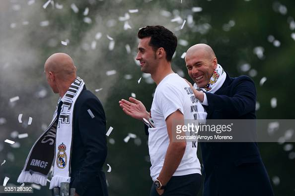 Head coach Zinedine Zidane of Real Madrid CF jokes with his player Alvaro Arbeloa during their team celebration at Cibeles square after winning the...