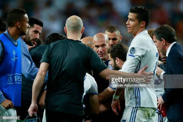 Head coach Zinedine Zidane of Real Madrid CF looks to his player Cristiano Ronaldo during the break of the extra time given after the UEFA Champions...