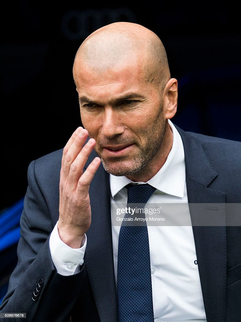 Head coach <a gi-track='captionPersonalityLinkClicked' href=/galleries/search?phrase=Zinedine+Zidane&family=editorial&specificpeople=172012 ng-click='$event.stopPropagation()'>Zinedine Zidane</a> of Real Madrid CF reacts as he enters to the pitch prior to start the La Liga match between Real Madrid CF and Athletic Club at Estadio Santiago Bernabeu on February 13, 2016 in Madrid, Spain.