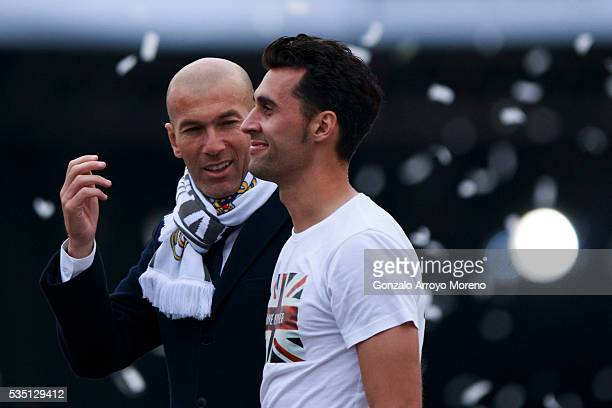 Head coach Zinedine Zidane of Real Madrid CF speaks with his player Alvaro Arbeloa during their team celebration at Cibeles square after winning the...