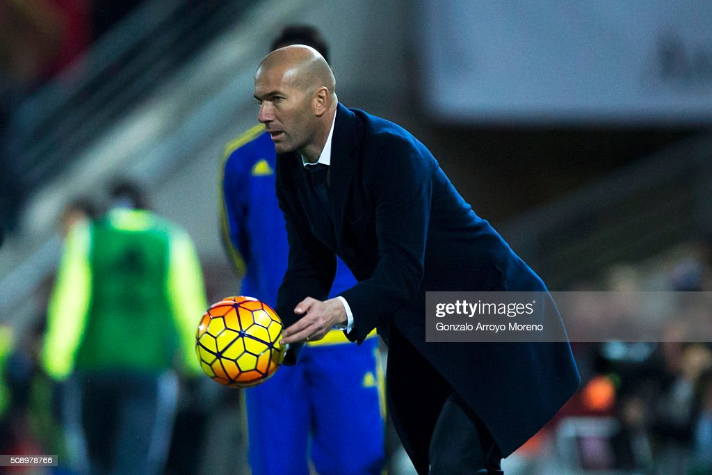 Head coach <a gi-track='captionPersonalityLinkClicked' href=/galleries/search?phrase=Zinedine+Zidane&family=editorial&specificpeople=172012 ng-click='$event.stopPropagation()'>Zinedine Zidane</a> of Real Madrid CF takes the ball during the La Liga match between Granada CF and Real Madrid CF at Estadio Nuevo Los Carmenes on February 7, 2016 in Granada, Spain.