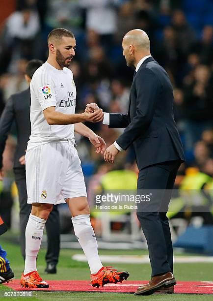 Head coach Zinedine Zidane of Real Madrid congratulates Karim Benzema after the La Liga match between Real Madrid CF and Real CD Espanyol at Estadio...