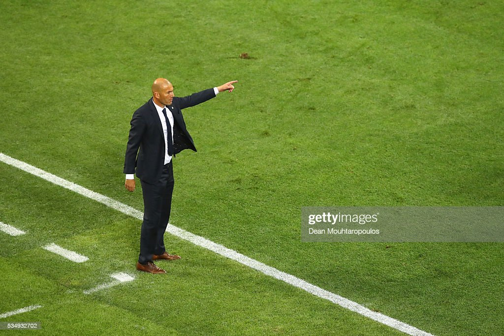Head coach <a gi-track='captionPersonalityLinkClicked' href=/galleries/search?phrase=Zinedine+Zidane&family=editorial&specificpeople=172012 ng-click='$event.stopPropagation()'>Zinedine Zidane</a> of Real Madrid gestures during the UEFA Champions League Final match between Real Madrid and Club Atletico de Madrid at Stadio Giuseppe Meazza on May 28, 2016 in Milan, Italy.