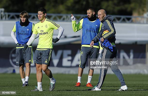 Head coach Zinedine Zidane of Real Madrid gives instructions during a training session at Valdebebas training ground on January 12 2016 in Madrid...